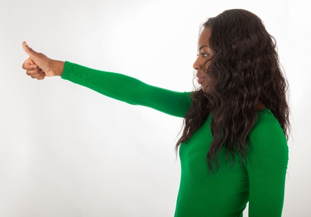 The thumb of a black woman is upturned Stock Photo - 18205351