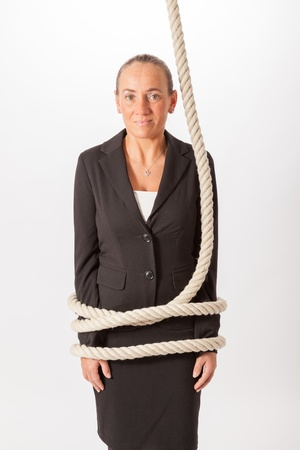The young woman is tied with a rope photo