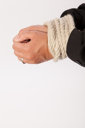 The hands of a young woman are handcuffed photo