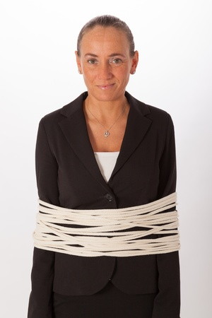 The young woman is tied with a rope Stock Photo - 18334245