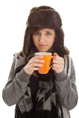 The young girl is drinking a cup of tea photo