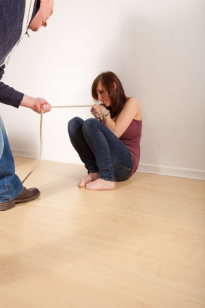 handcuffed: The young girl is handcuffed
