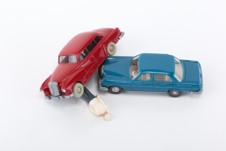 A red and a blue car have crashed Stock Photo