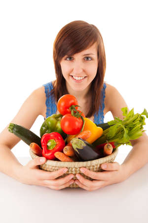 A young woman with a basket full of vegetables photo