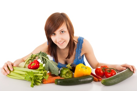 The young woman with her arm full of vegetables photo