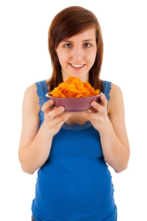 likes: The young woman likes eating chips Stock Photo