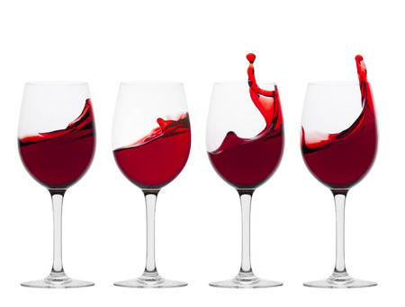 Wine glasses with splash of wine Stock Photo