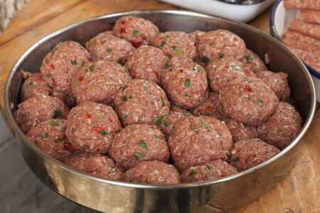 food state: Raw italian style meatballs ready to be cooked in pasta sauce Stock Photo