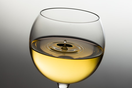 muscadet: Pouring white wine drop by drop