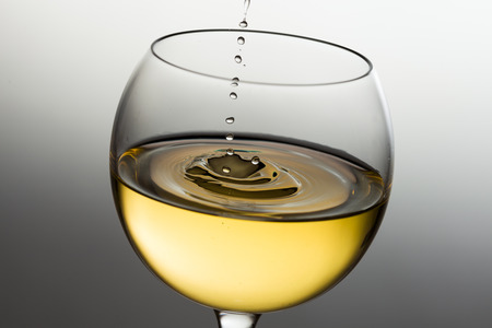 pinot grigio: Pouring white wine drop by drop
