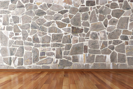Empty room with stone wall and wooden floor Banco de Imagens