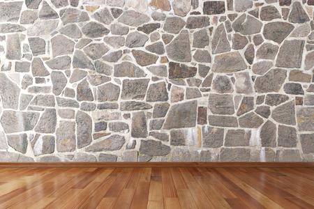 Lege kamer met stenen muur en houten vloer Stockfoto