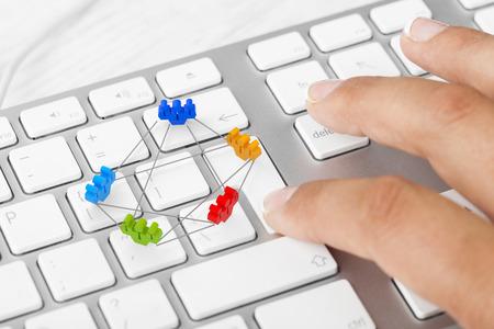 Woman pushing teamwork key on keyboard photo