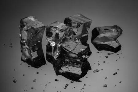 ice crushed: Crushed ice cubes on reflective black background