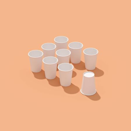 Pattern of empty paper disposable cups are laying on a background with hard shadows Standard-Bild - 134686955