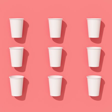 Pattern of empty paper disposable cups are laying on a background with hard shadows Standard-Bild - 134686962