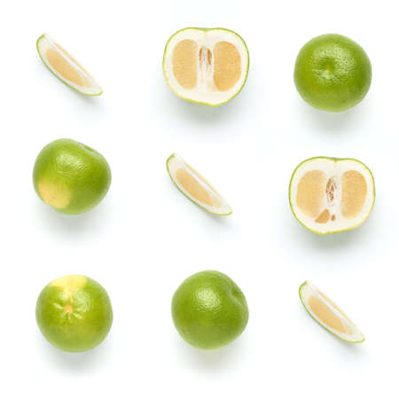 Citrus Sweetie or Pomelit, oroblanco with slices isolated on white background close-up. Top view. Flat lay Stock Photo