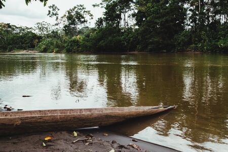 old aboriginal boat on a river in the amazon, ecuador