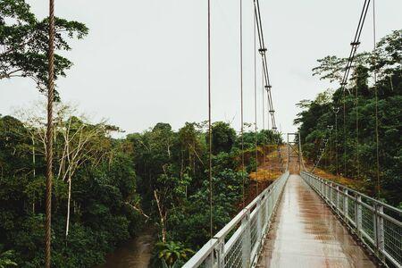 bridge over the river in the amazon, metal structure, large bridges. Ecuador Stock Photo
