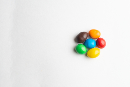 Colorful chocolate candies on the white background