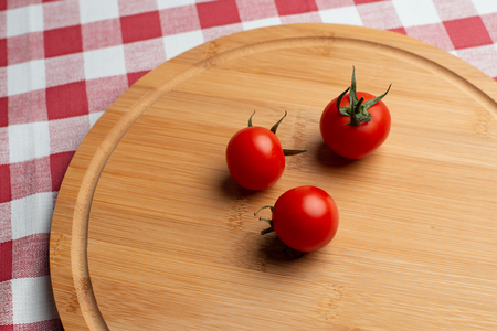 Tomates for lunch on the wooden background