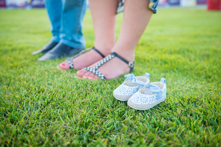 Pregnant woman, Pregnancy, Father and mother, Waiting new baby girl, new born baby, Shoes of new born baby