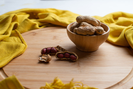 Walnuts kernels on dark desk with color background, Whole walnut in wood vintage bowl, Nuts in bamboo wooden bowl, walnuts in wood bamboo bowl