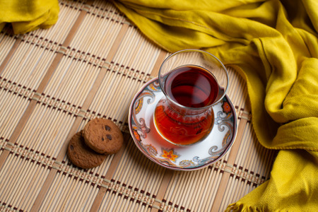 Homemade oatmeal cookies with a cup of tea on old wooden background, A cup of tea with raisin, a cup of tea with chocolate