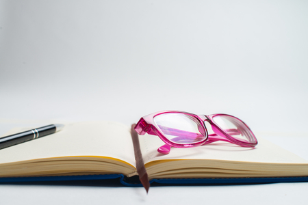 Notebook with glasses and pen, Book with glasses, Blue notebook with glasses, Book with cup of tea, working with glasses and pen, write to notebook 写真素材
