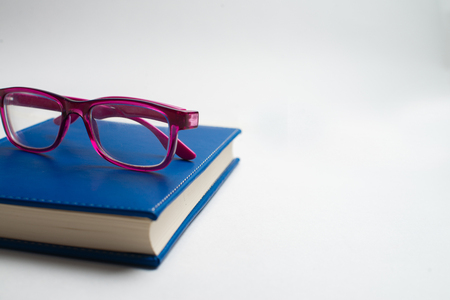 Notebook with glasses and pen, Book with glasses, Blue notebook with glasses, Book with cup of tea, working with glasses and pen, write to notebook Banque d'images