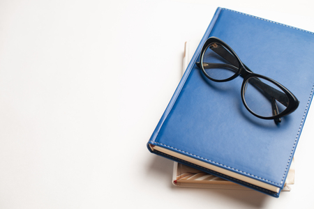 Notebook with glasses and pen, Book with glasses, Blue notebook with glasses, Book with cup of tea, working with glasses and pen, write to notebook Imagens