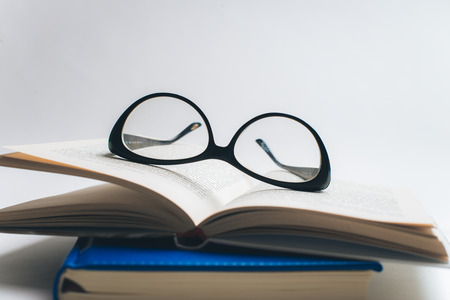 Notebook with glasses and pen, Book with glasses, Blue notebook with glasses, Book with cup of tea, working with glasses and pen, write to notebook 版權商用圖片