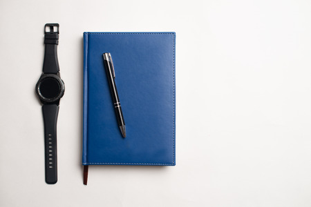Notebook with glasses and pen, Book with glasses, Blue notebook with glasses, Book with cup of tea, working with glasses and pen, write to notebook Stock Photo