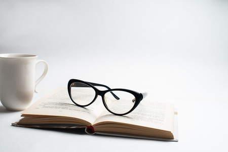 Notebook with glasses and pen, Book with glasses, Blue notebook with glasses, Book with cup of tea, working with glasses and pen, write to notebook Zdjęcie Seryjne