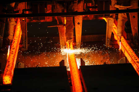 Steel billets at torch cutting in metallurgical plant. Metallurgical production, heavy industry, engineering, steelmaking. Фото со стока
