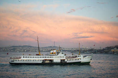 Ferry and red sunset in Istanbul Stock Photo