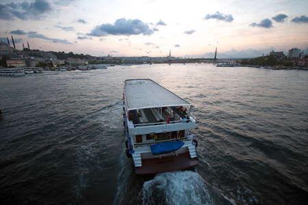 Ferry boat in Marmara Sea in Golden Horn Istanbul at sunset time Stock Photo