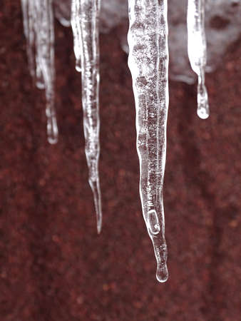 icicles on the roof after snowy cold weather Foto de archivo