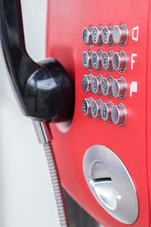 Closeup buttons of the red public telephone. Selective focus