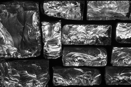 Uneven glass blocks on black background. Abstract pattern 版權商用圖片