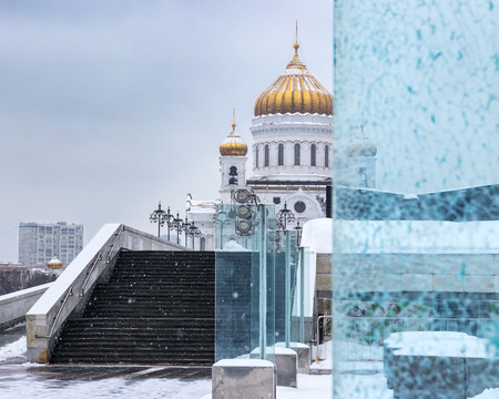 Cathedral of Christ the Saviour in the snowfall. Part of the Cathedra through the broken glass