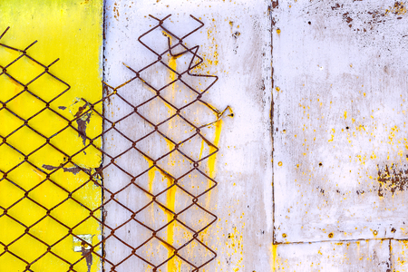 Metal sheets with peeling paint. Rusty wire mesh. Abstract background. Spotted pattern