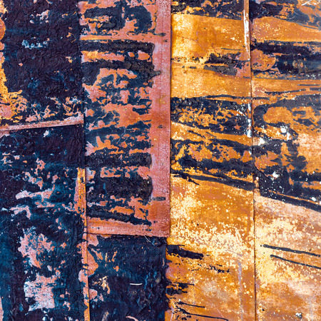 Metal sheets with peeling and burned paint. Abstract background. Spotted pattern