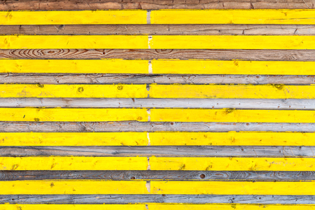 Lateral wooden planks with alternating yellow color and natural texture. Wood pattern