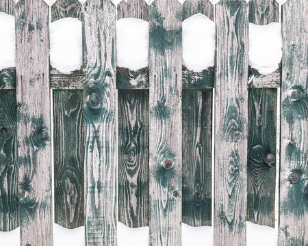 Texture of the wooden fence covered with snow. Wood pattern