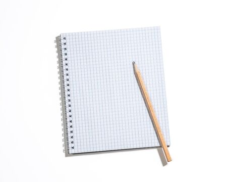 Spiral notebook in a cage with a pencil isolated on white. Top view, copyspace