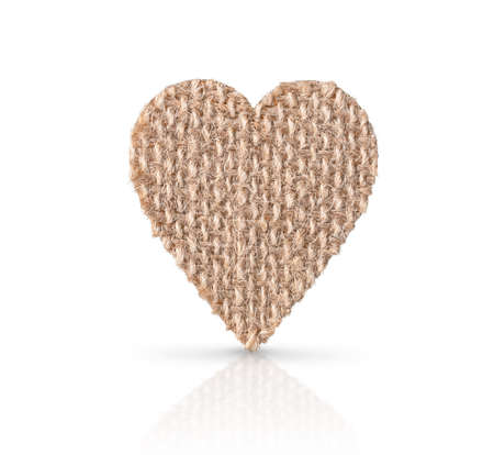 Burlap fabric heart isolated on white background with soft shadow and reflection