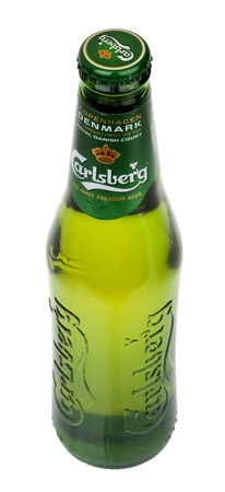 Tel-Aviv, Israel - 20th, March 2011: A 0.33 liter bottle of cold Carlsberg beer, isolated on white background.  Carlsberg is a pale lager (pilsner) beer that originates in Denmark, first brewed in 1904.