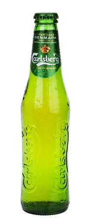 carlsberg: Tel-Aviv, Israel - 20th, March 2011: A 0.33 liter bottle of cold Carlsberg beer sweating drops of water, isolated on white background. Carlsberg is a pale lager (pilsner) beer that originates in Denmark, first brewed in 1904. Editorial