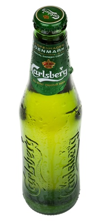 carlsberg: Tel-Aviv, Israel - 20th, March 2011: A 0.33 liter bottle of cold Carlsberg beer sweating drops of water, isolated on white background. Shot from a high angle.